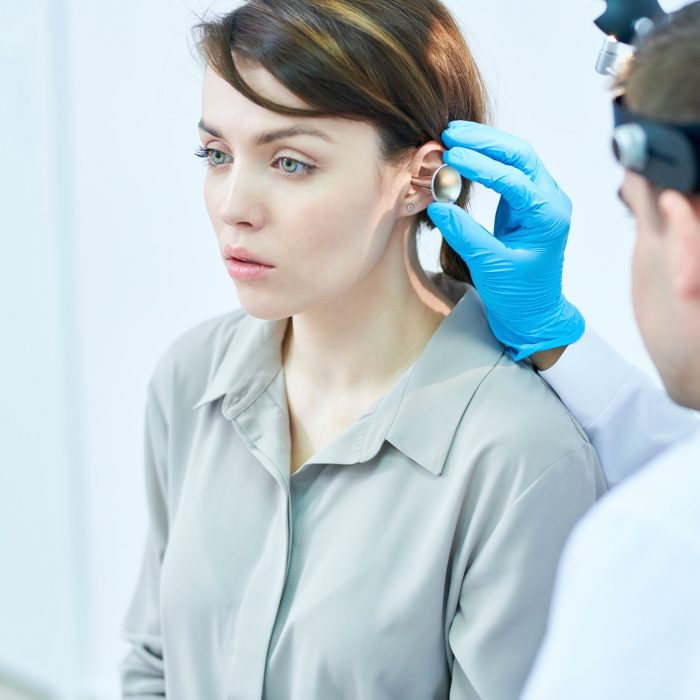 Audiologist Examining Hearing